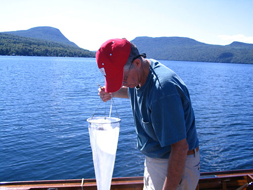 Limnologist-Plankton-net-and-mountains.jpg