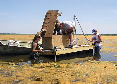 Emiquon Crew Installing Water Quality Instruments