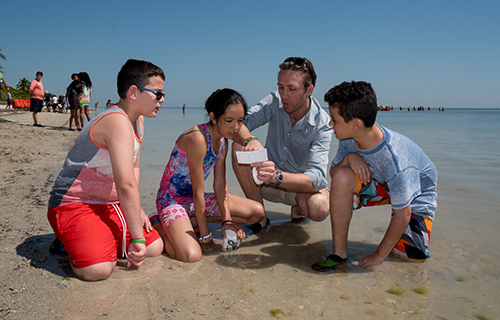 Mission-Water-Philippe-with-Kids-at-Shoreline.jpg